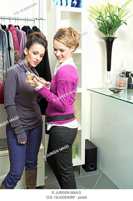 Two women looking at some perfume