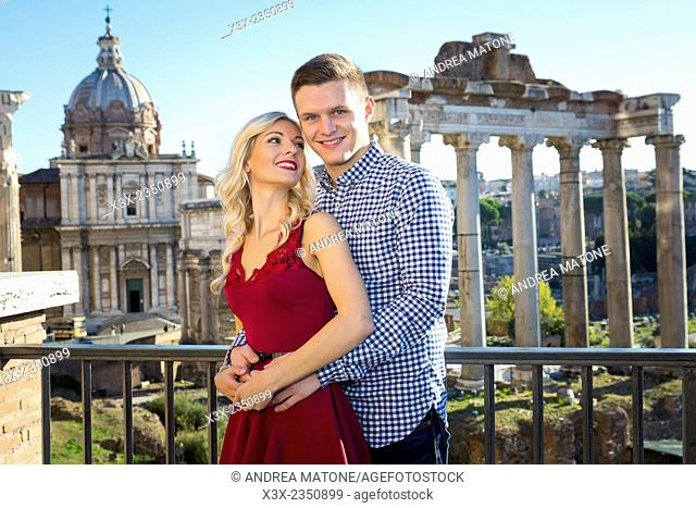 Couple smiling at the Roman Forum. Rome, Italy