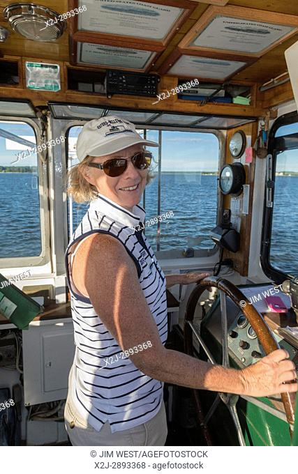 Oxford, Maryland - Marcia LoVerdi pilots the Bellevue-Oxford car ferry across the Tred Avon River near the Chesapeake Bay