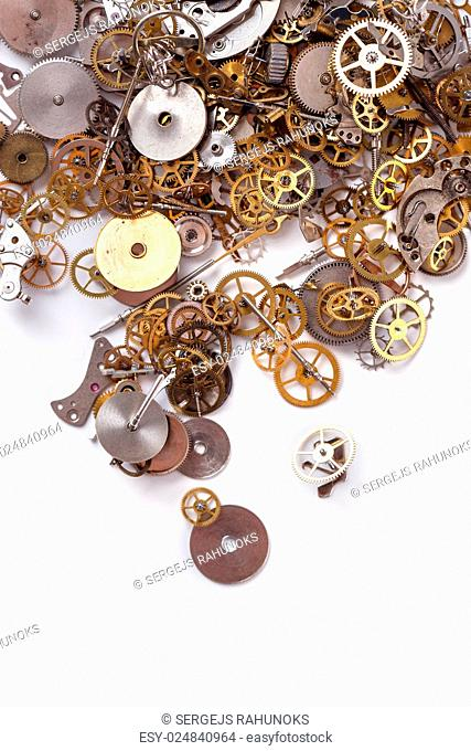 Details, technology. Heap of small gears on a white background