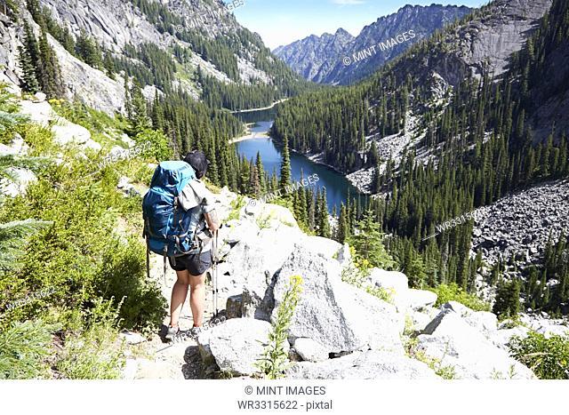 Hiker walking on rocky hillside