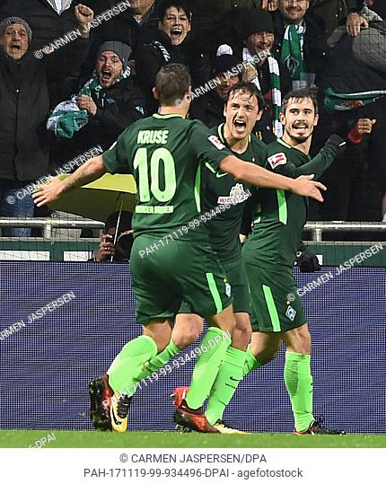Bremen's goalscorer of the 1-0 goal, Fin Bartels (R), celebrates with team mates Max Kruse (L) and Thomas Delaney during the German Bundesliga soccer match...