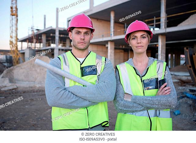 Portrait of surveyor and architect on construction site