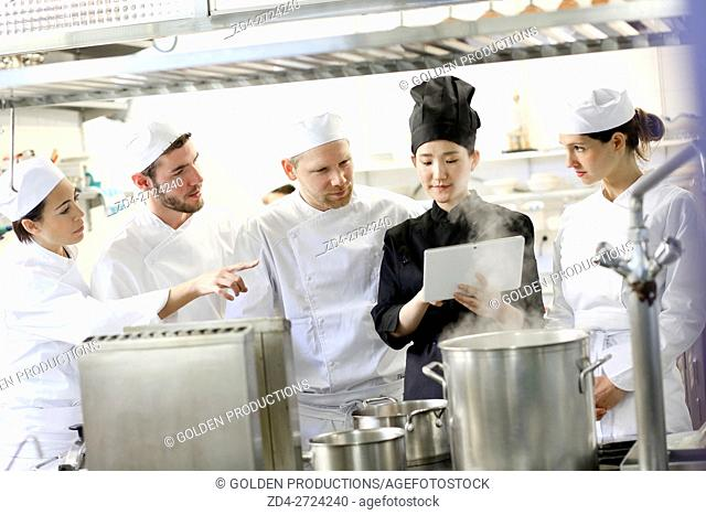 Chefs preparing menu in restaurant kitchen