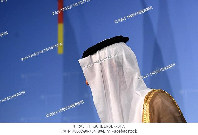 Saudi Arabian Foreign Minister Adel bin Ahmed Al-Jubeir walks past a blue wall after a press conference at the Federal Foreign Office inBerlin,Germany