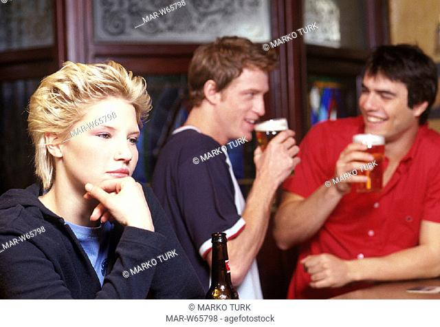 young people drinking a beer, pub