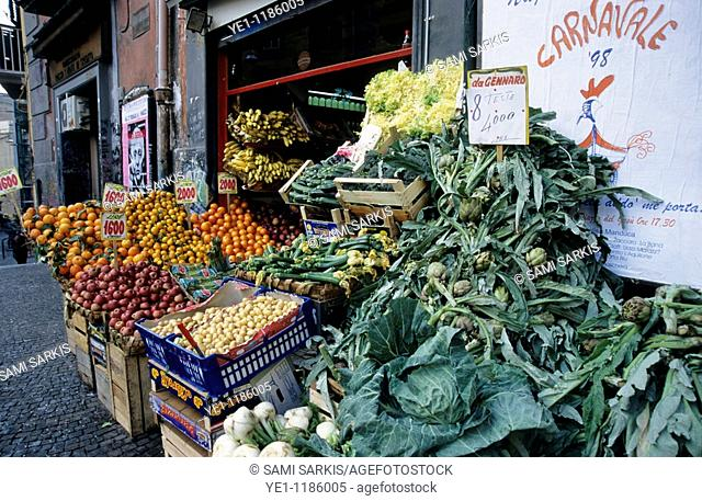 Fruit and vegetables on display outside a shop on the Piazza Del Gesu Nuovo, Naples, Italy