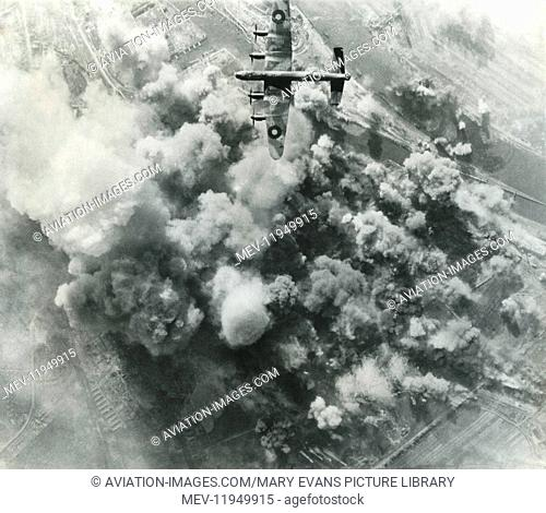 A Royal Airforce Avro 683 Lancaster Dropping Bombs on an Oil-Refinery in Bremen, Germany During a Daylight Raid with Cloud of Smoke on 21st March 1945