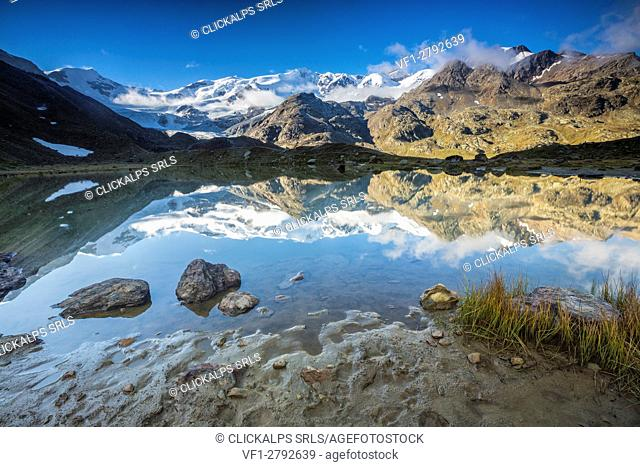 Sunrise at Lake Rosole with Peak San Matteo in the background Forni Valley Valfurva Valtellina Lombardy Italy Europe