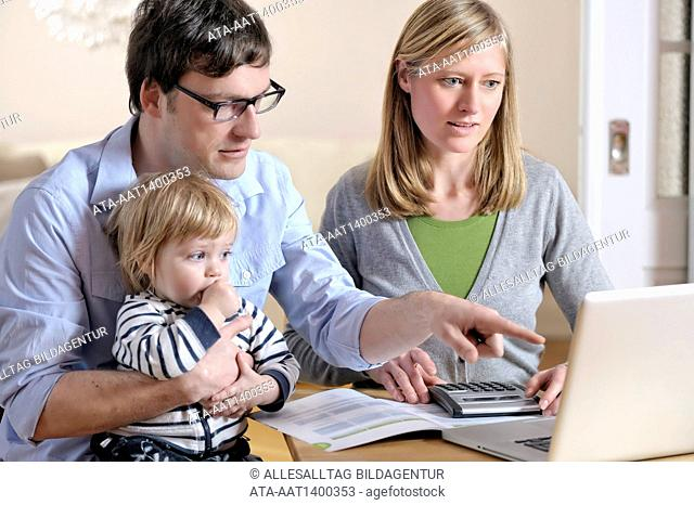 Young family is checking their finances
