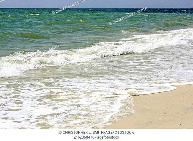 The waves lapping along the coastline at Bonita beach Florida