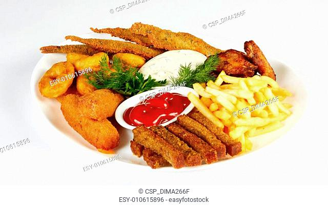 roasted fish and chicken wings served with french fries and rusks