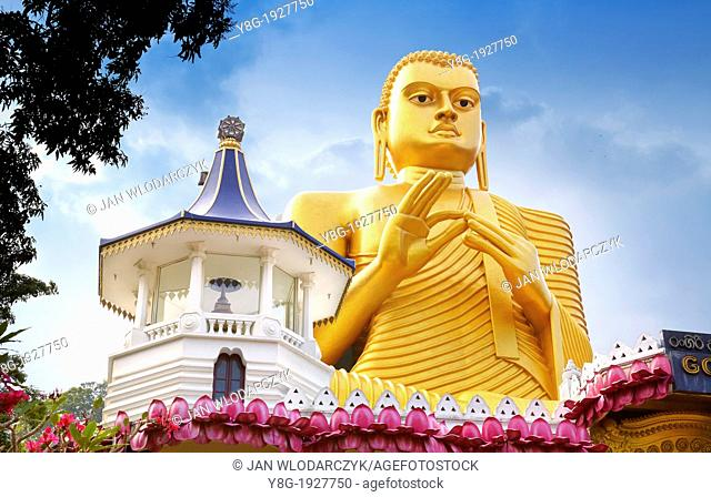 Sri Lanka - Dambulla, Golden Buddha statue over the Buddish Museum, Kandy province, UNESCO World Heritage Site, central region of Sri Lanka Island