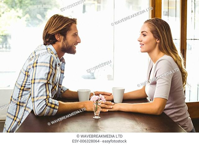 Happy couple enjoying a coffee at the coffee shop