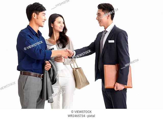 Young couple with car dealer