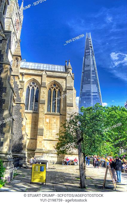 HDR image of Southwark Cathedral or The Cathedral and Collegiate Church of St Saviour and St Mary Overie, Southwark with the Shard in the distance