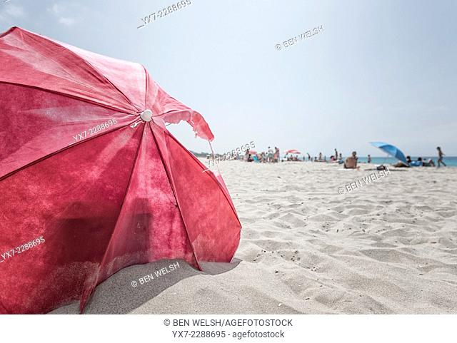 Old beach umbrella. Tarifa, Cadiz, Costa de la Luz, Andalusia, Spain