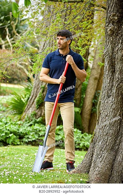 Gardener with hand tool, Garden, Digging shovel, Aiete Park, Donostia, San Sebastian, Gipuzkoa, Basque Country, Spain, Europe