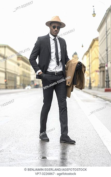 Fashionable man walking on the street. Munich, Germany