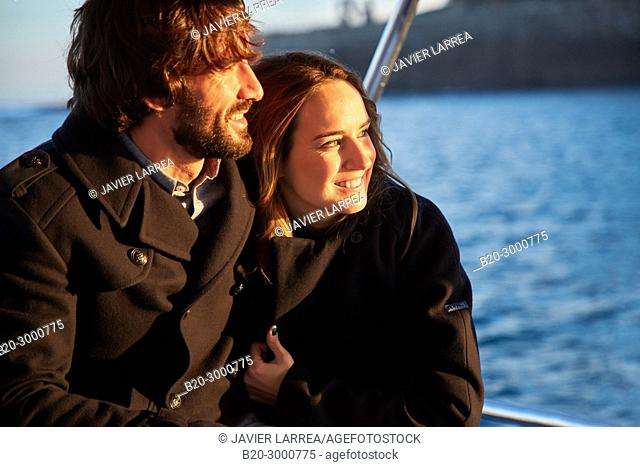 Couple on a boat trip to Santa Clara Island, Donostia, San Sebastian, Gipuzkoa, Basque Country, Spain, Europe, Winter