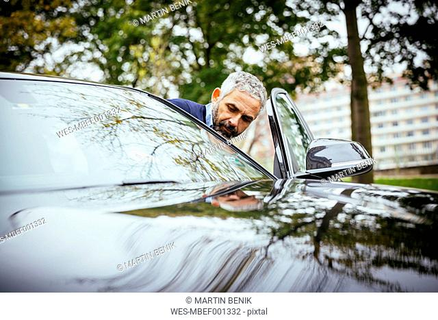 Man getting into his car