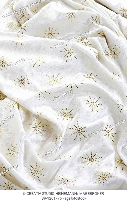 White fabric with gold stars, full-frame
