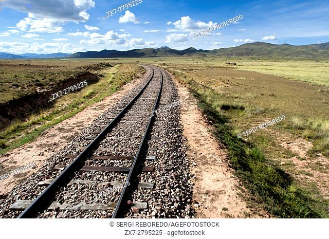 Andean Explorer, luxury train from Cusco to Puno. Peruvian altiplano landscape seen from inside the Andean Explorer train Orient Express which runs between...