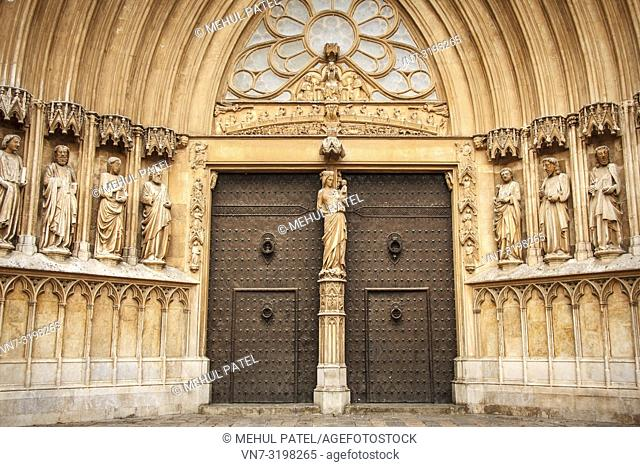 The grand door and facade of Tarragona Cathedral, Catalonia, Spain. The cathedral is situated in the old town of Tarragona at the city's highest point and was...