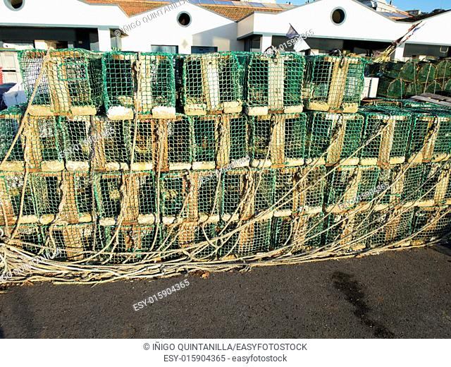 stack of wooden fishing creels in Ribadesella public port Asturias Spain Europe