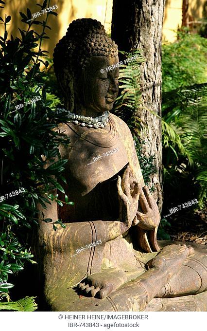 Buddha statue, lotus position, Balinesischer Garten (Balinese Gardens), Muehldorf am Inn, Bavaria, Germany