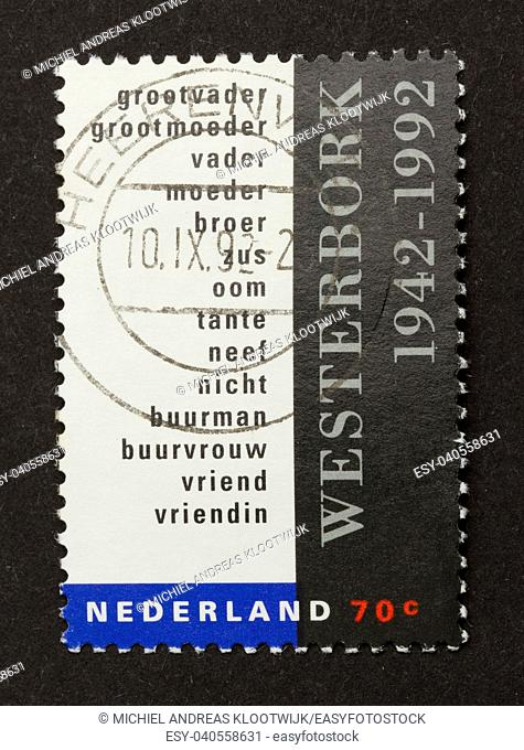 HOLLAND - CIRCA 1980: Stamp printed in the Netherlands shows family in the german camp Westerbork during WWII, circa 1980