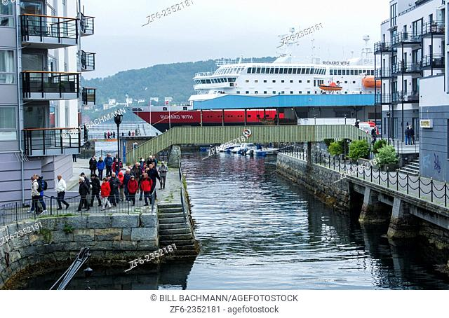 Alesund Norway cruise Hurtigruten water with boats near pier and homes apartments on water
