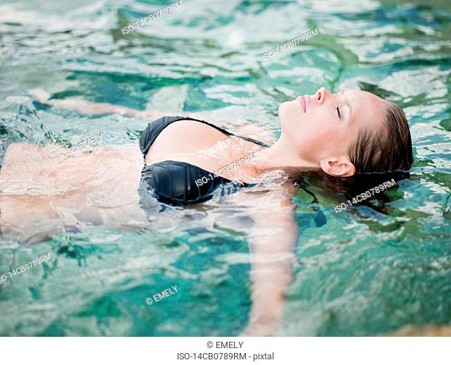 woman swimming eyes closed