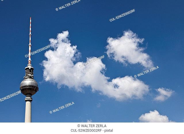 Striped spire against blue sky