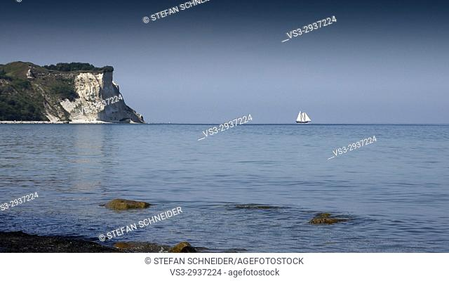 Sailing ship at the horizon of Baltic Sea and the limestone cliffs on the Left, Cape Arkona, Island of Rügen, Mecklenburg-Western Pomerania, Germany