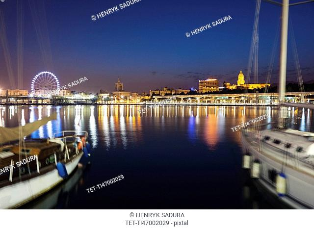 Spain, Andalusia, Seville, Waterfront with sailboats in foreground