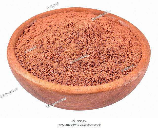 Cocoa powder in a wooden bowl on a white background