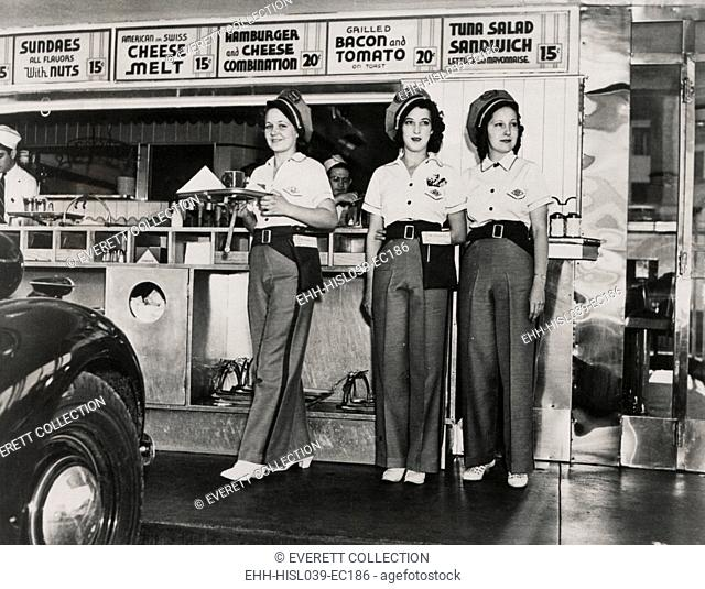 Drive-in restaurant in Hollywood, Los Angeles. June 29, 1938. The waitresses wear pseudo Highway Patrol Uniforms. The Fast Food menu includes: Hamburger and...