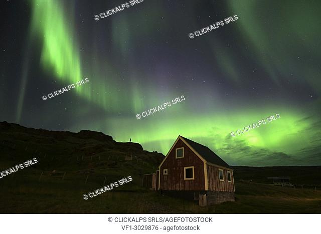 Nordic little red house with northern Lights,Qassiarsuq, Greenland