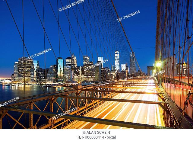 Illuminated Brooklyn Bridge at night