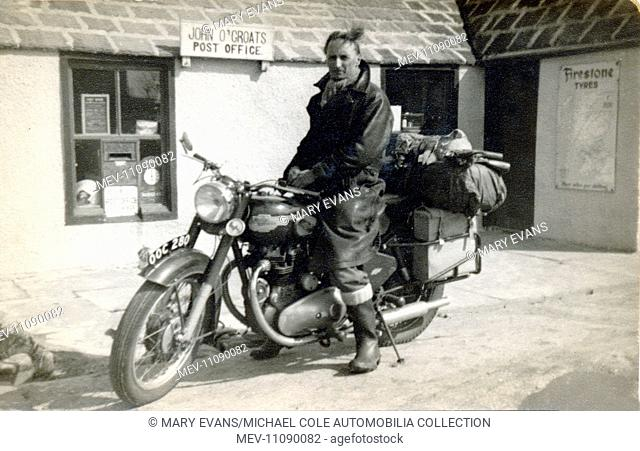 Travelling biker on his 1956/7 Royal Enfield Meteor motorcycle outside the Post Office at John O' Groats in the late 1950s