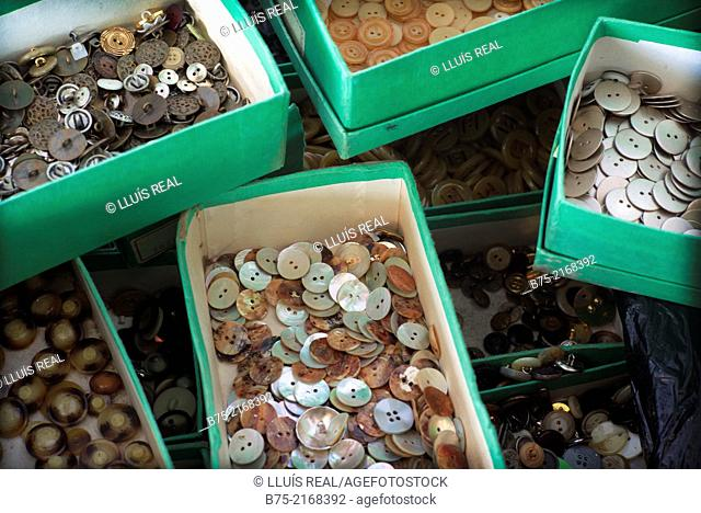 Closeup of boxes full of buttons in Els Encants market in Barcelona, Spain, Europe