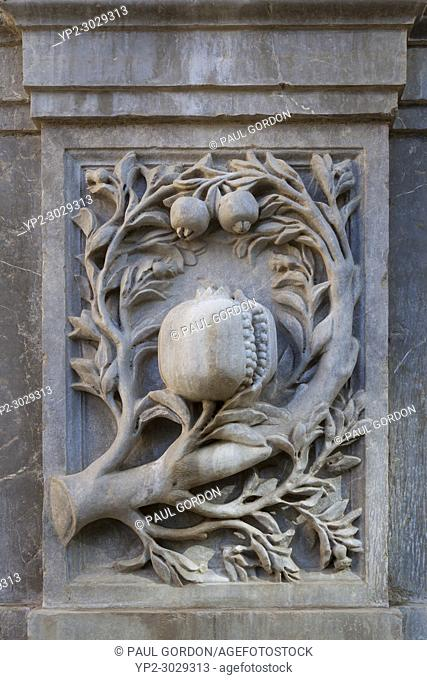 Granada, Spain: Intricate stone carving of pomegranate branches on Charles Vâ. . s Pillar at the Alhambra Palace and Fortress