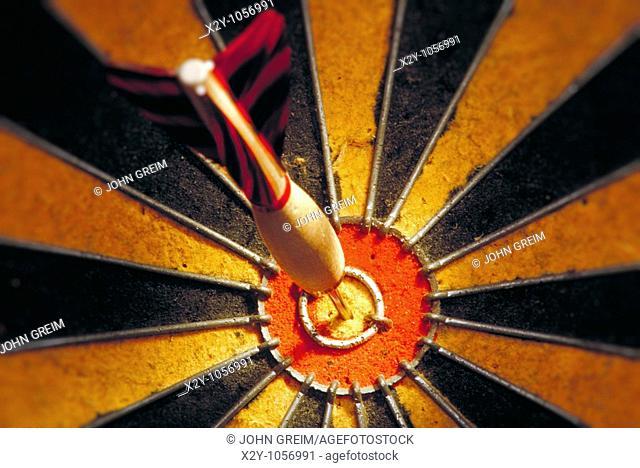 Dart in bulls eye of a dart board