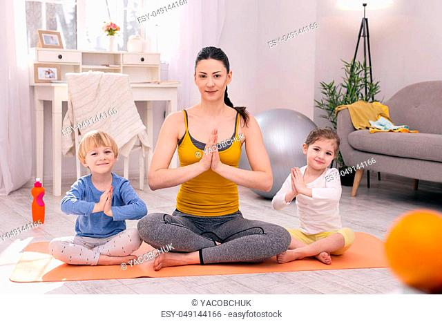 Kids doing yoga Stock Photos and Images | age fotostock