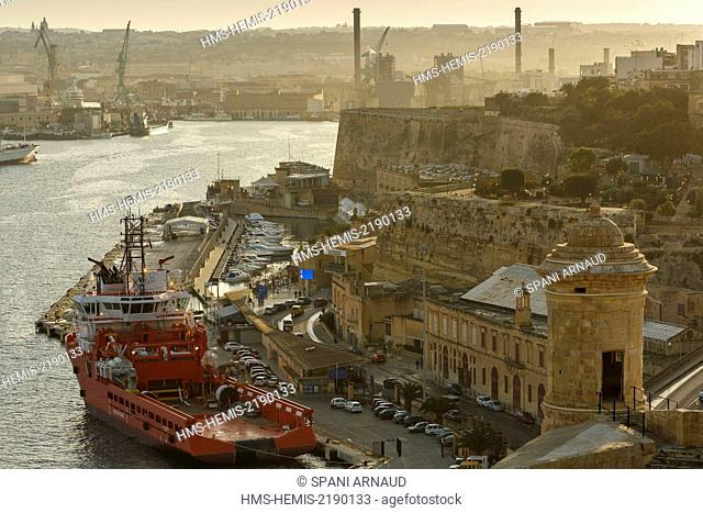 Malta, Valletta, listed as World Heritage by UNESCO, view docks and shipyards Valletta Bay at sunset