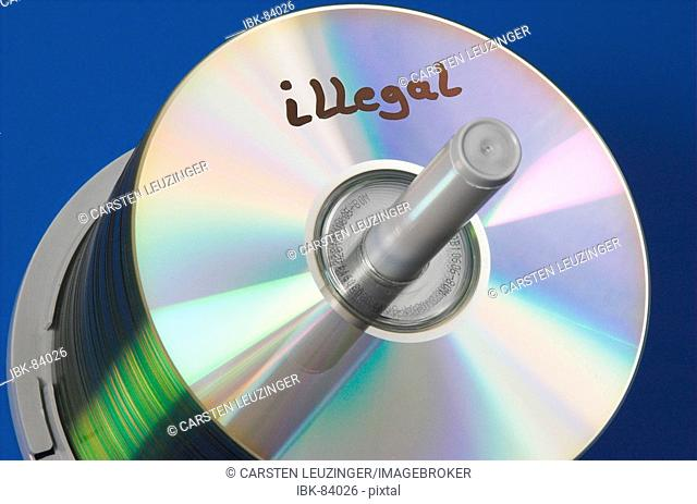Stack of CD media labeled illegal