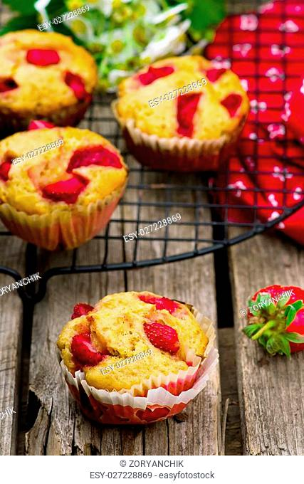 muffins with bran and strawberry. healthy food. style rustic. selective focus