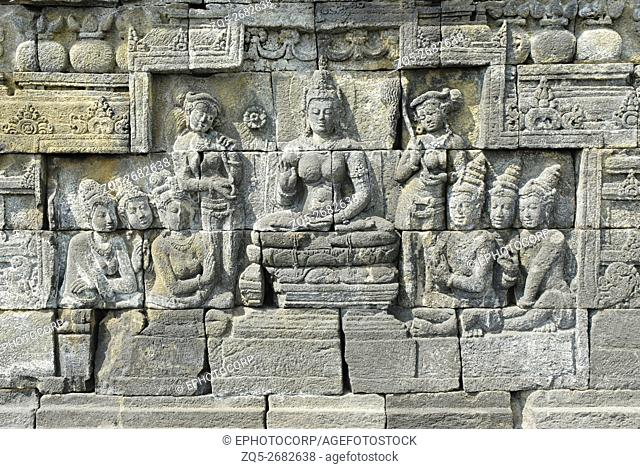Indonesia-Java-Borobudur, Goddess seated on lotus throne with attendants and Devotees, closer-view