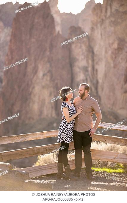 Lifestyle portrait of an engaged couple that loves the outdoors at Smith Rock State Park in Central Oregon